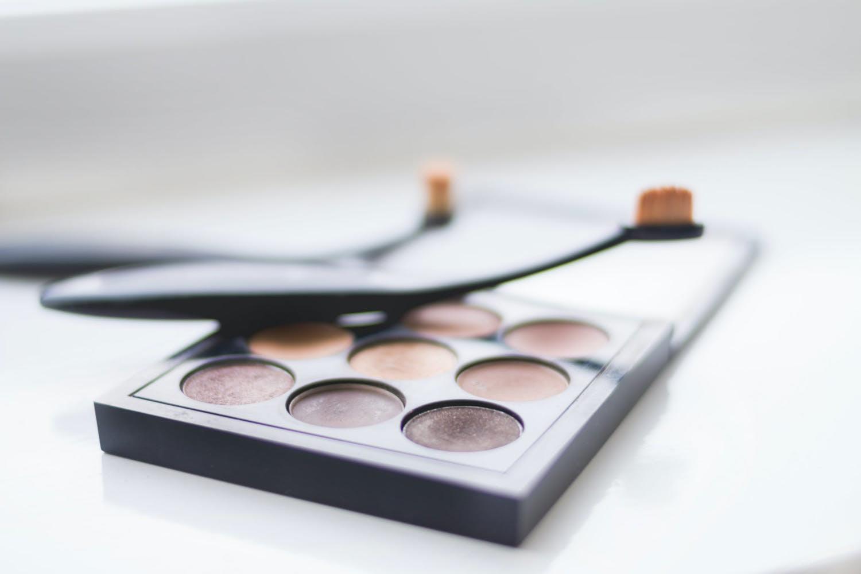 a close-up photo of a makeup palette on a plain background