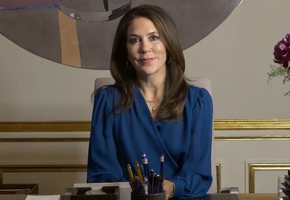 The Ministry of Education. Crown Princess Mary wore a dark blue self-tie wrap silk long sleeve blouse long sleeve top from Michael Kors