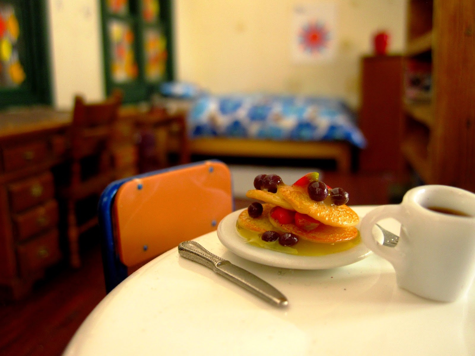 Dolls house miniature brunch of berry pancakes and coffee.