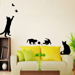 Dibujos de gatos en la pared