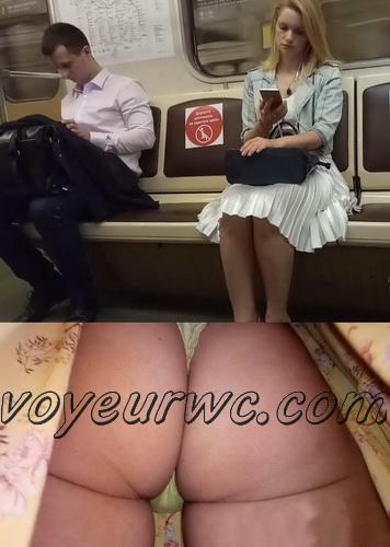 Upskirts 4570-4579 (Secretly taking an upskirt video of beautiful women on escalator)