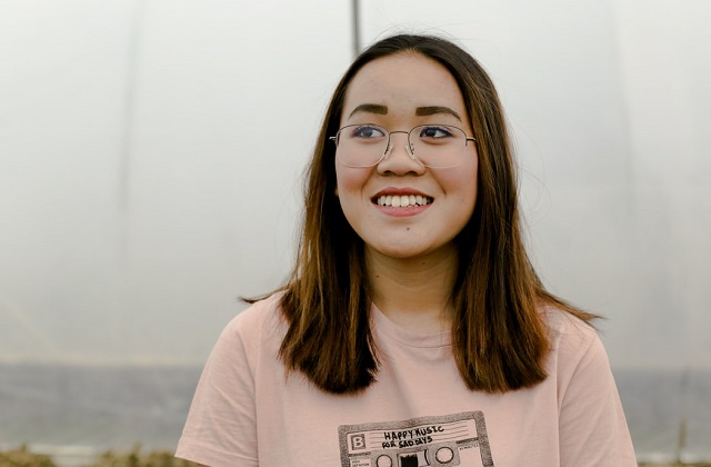 woman in shirt with glasses smiling