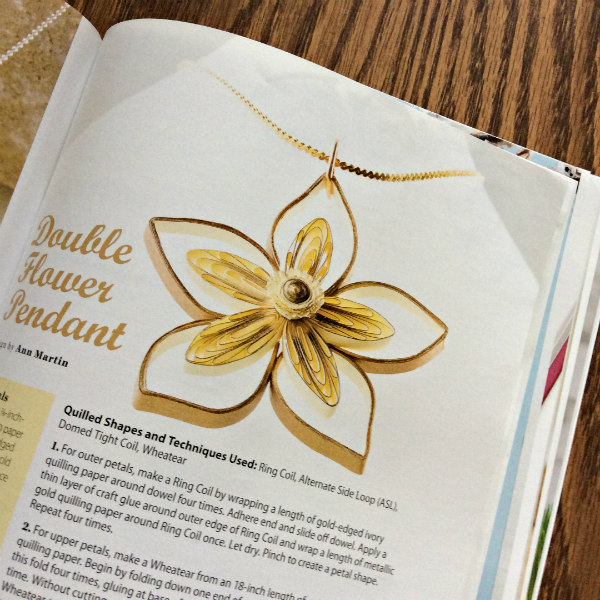 golden paper quilled double flower pendant on a gold necklace chain as seen on the Creative Paper Quilling book page