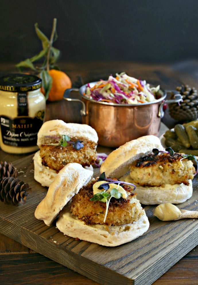 Recipe for mini crispy buttermilk and mustard marinated chicken sandwiches served on biscuits.