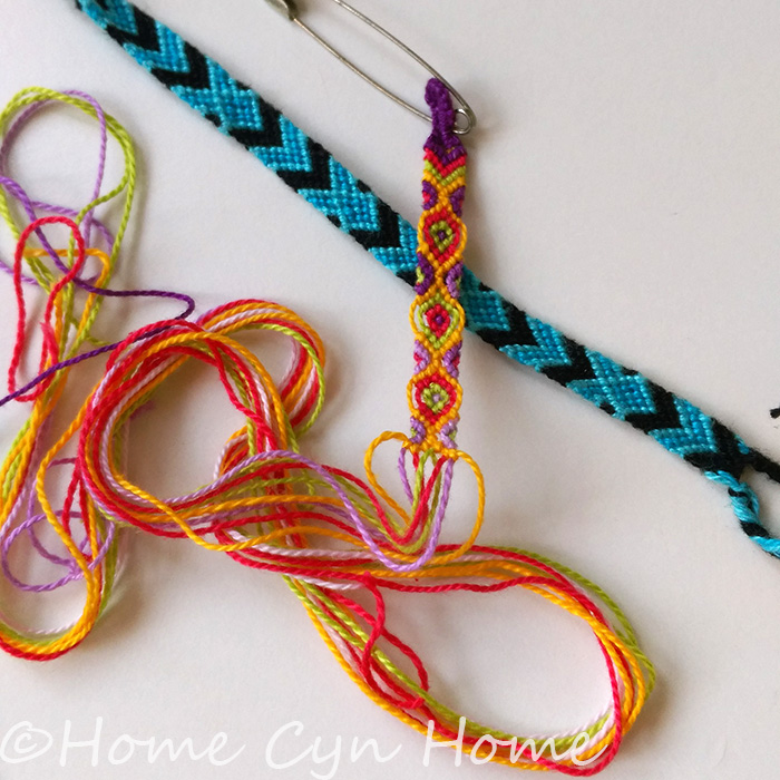 Friendship bracelets are nothing more than a series of simple knots tied in a specific order between different colours of thread to form a pattern