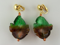 http://www.thecliponearringstore.com/green-and-amber-leaf-twist-clip-on-earrings.html