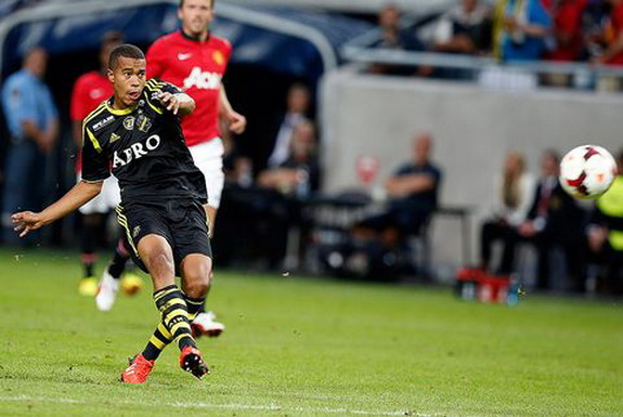 AIK player Robin Quaison shoots to score the opening goal against Manchester United