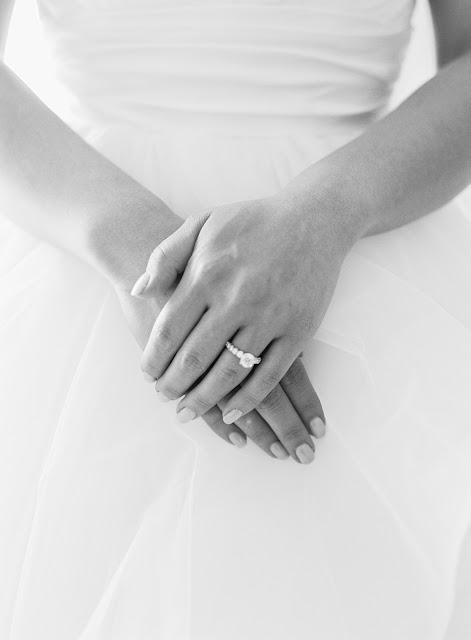 Jin's hands and ring on her wedding day