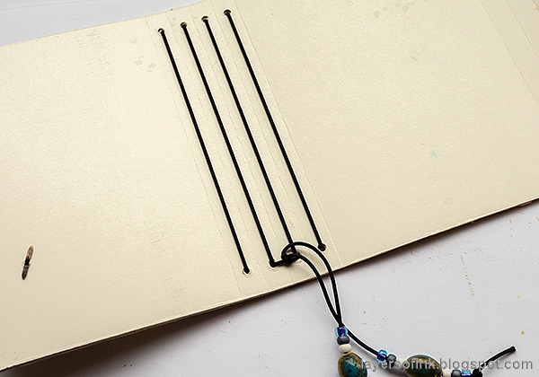 Layers of ink - Chickadee Wrapped Journal Tutorial by Anna-Karin Evaldsson. Bind the journal.