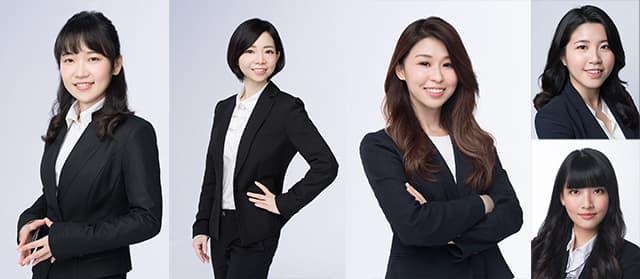 女律師穿著西裝外套的半身照片