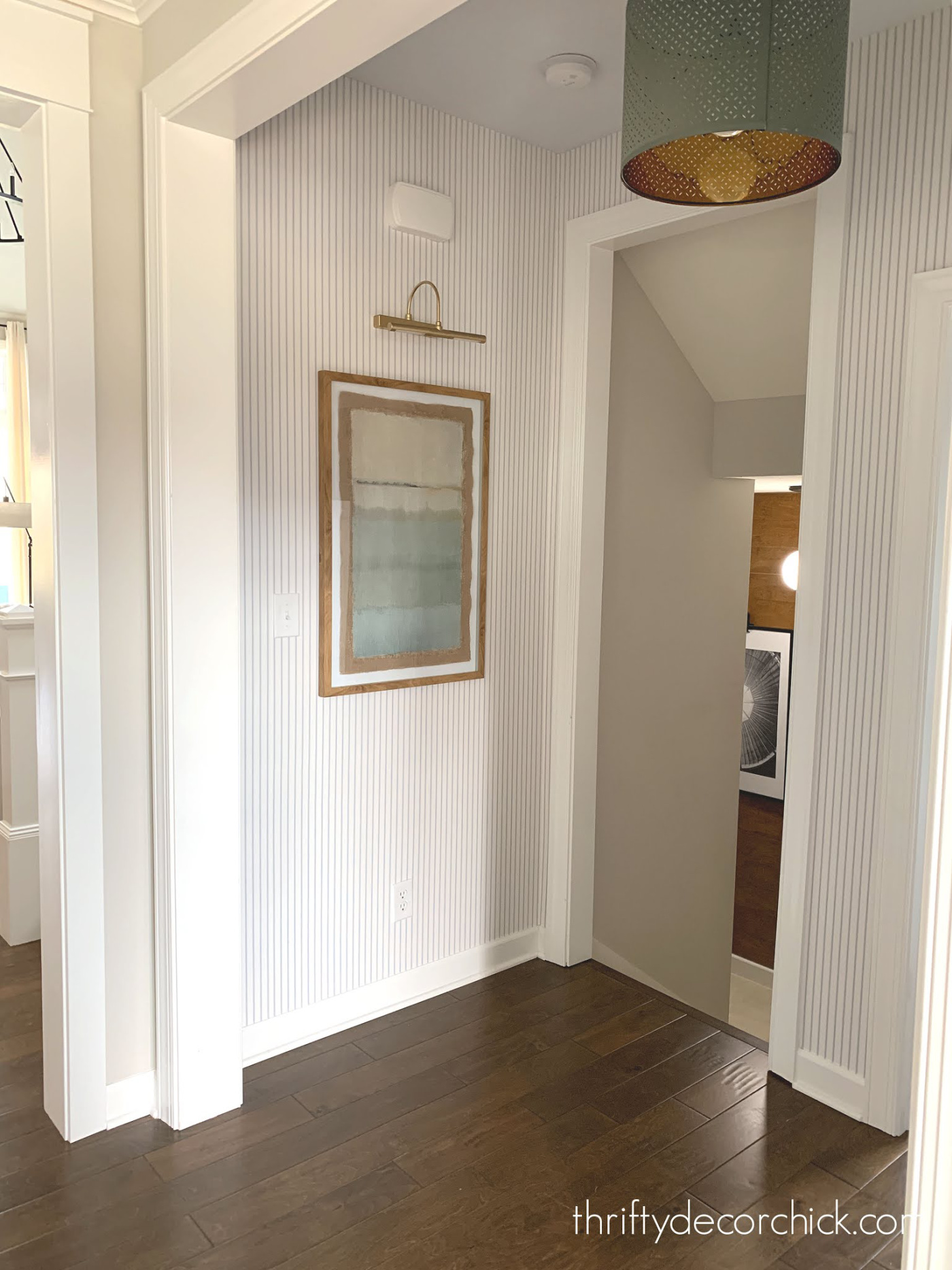 pinstripe wallpaper hallway by stairs