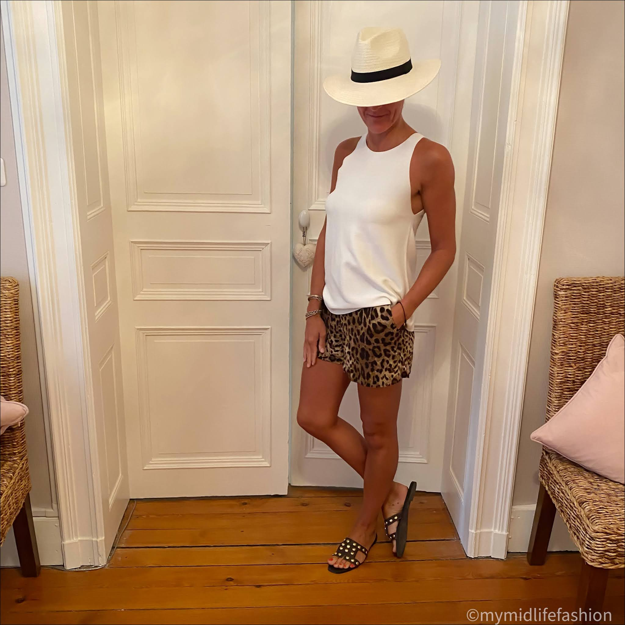 my midlife fashion, zara Panama hat, marks and Spencer knitted tank top, dolce and Gabbana leopard print shorts, zara leather studded sliders