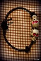 LoveLea's leather 2 red eyed skulls bracelet with sliding knot