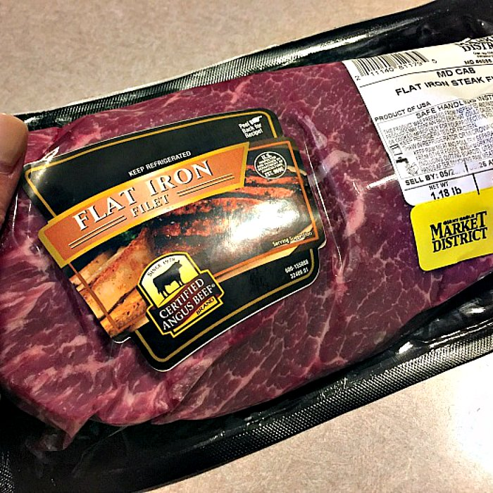 Uncooked, Certified Angus Beef (r) brand Flat Iron Steak in packaging