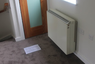 An installed storage heater in a passive solar house; proven, old technology meeting the new