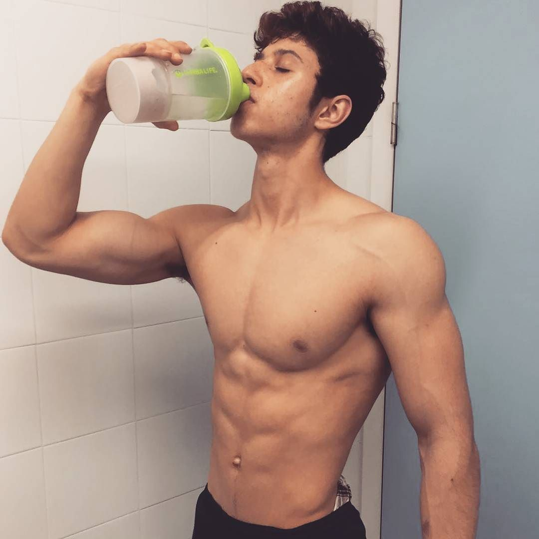 cute-young-fit-shirtless-boy-drinking-healthy