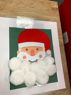a green background with a simple Santa graphic where his beard is made from cotton balls
