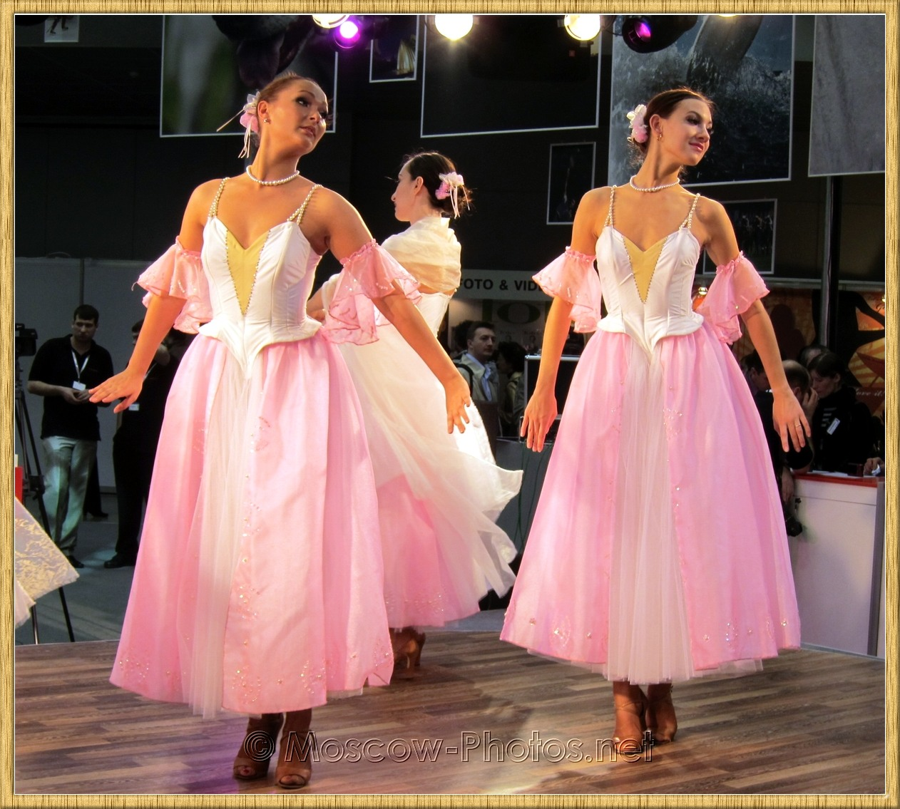 Dancing girls in pink dresses at Photoforum - 2010