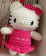 http://www.ravelry.com/patterns/library/crochet-kitty-hello-kitty-in-pink-dress-doll-toy