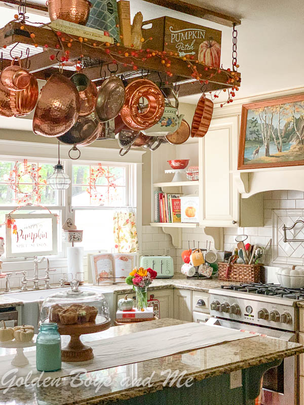 Cottage style kitchen with pot rack and farmhouse sink - www.goldenboysandme.com