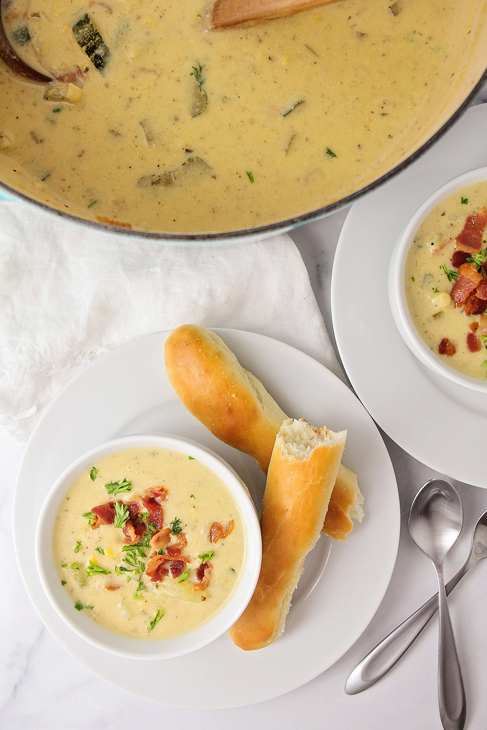 This delicious and savory zucchini corn chowder is the perfect way to enjoy those abundant summer vegetables!