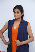 Priyamani in Beautiful Short Deep neck Orange Dress ~  Exclusive 44.JPG