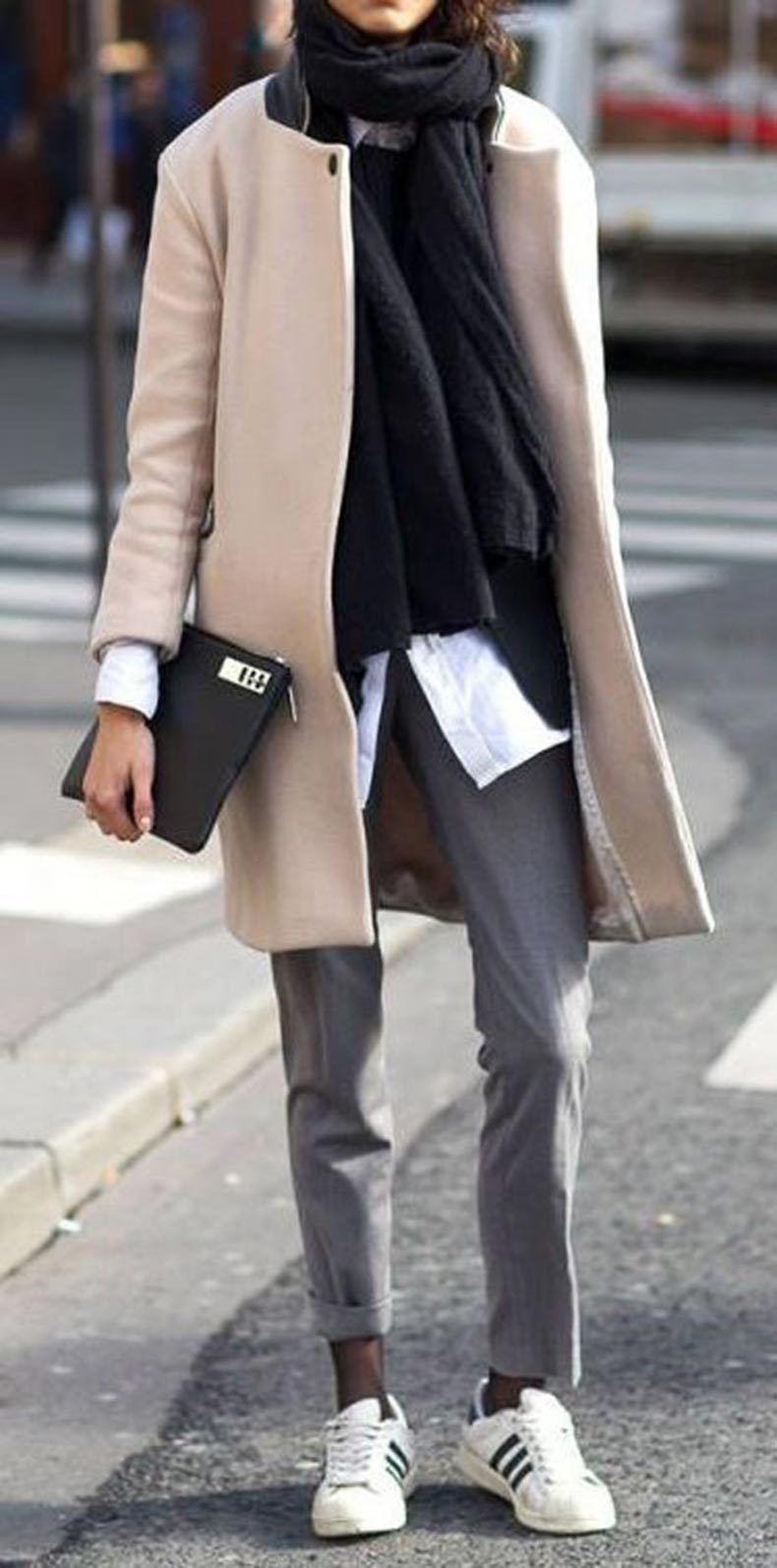 cool layered outfit idea / sneakers + grey pants + beige coat + scarf + shirt + clutch