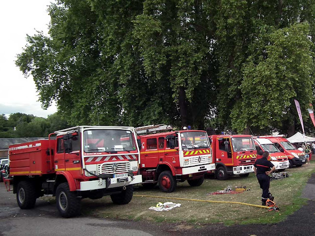 Rural fire brigade vehicles on display at an agricultural show.  Indre et Loire, France. Photographed by Susan Walter. Tour the Loire Valley with a classic car and a private guide.