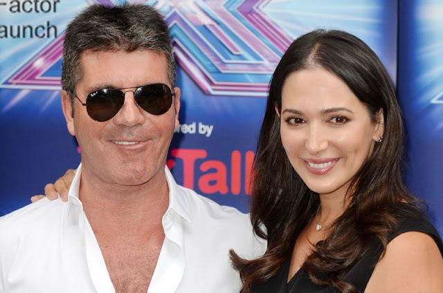 Simon Cowell has broken his back while testing his new electric bicycle