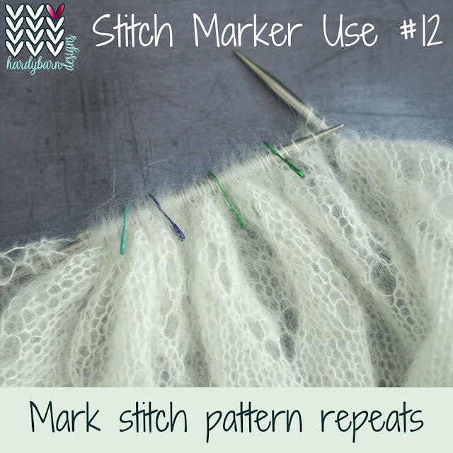 White mohair knitting with lots of markers on needle