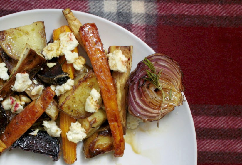 A simple dish of rosemary roasted root vegetables drizzled with balsamic vinegar and maple syrup topped with crumbled feta.  A welcome addition to any Sunday lunch!