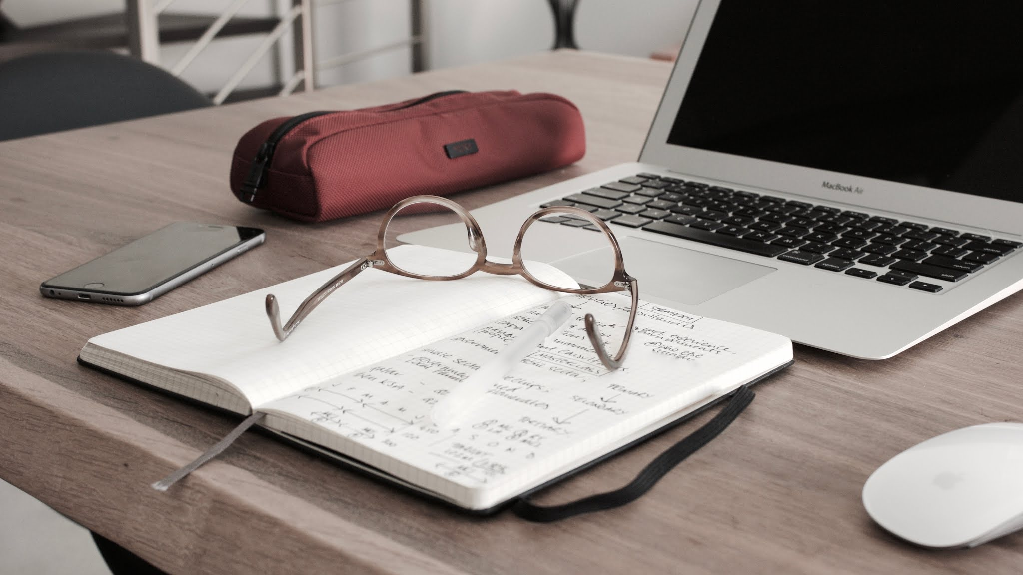 glasses on book beside laptop, studying at uk university first year student