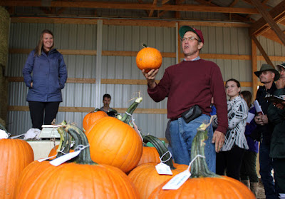 Rod Elmstrand holding pumpkin at field day
