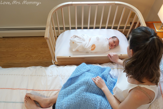 baby beside sleeper, baby looking at mommy, bedside sleeper, bedside crib, babybay, babybay bedside sleeper