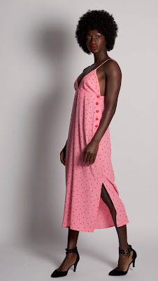 model standing pink dress