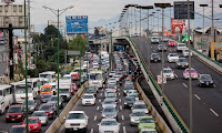 Cars sit in traffic in Mexico City, Mexico. (Photograph Credit: Brett Gundlock/Getty Images) Click to Enlarge.
