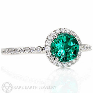 Rare Earth circular emerald engagement ring