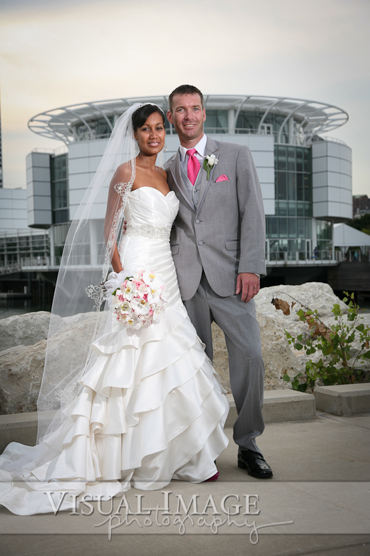 Portrait of Bride and Groom with Discovery World in the background