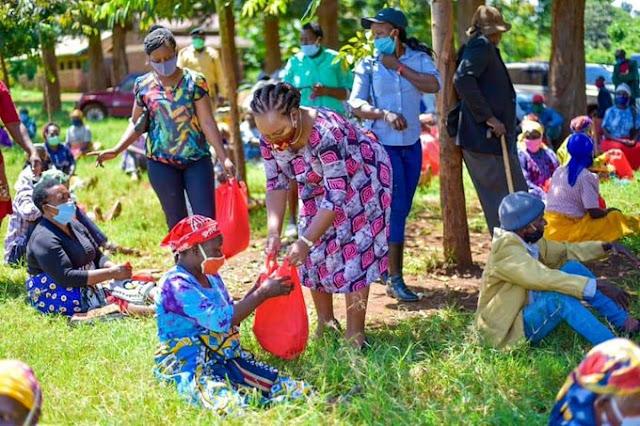 Governor Anne Waiguru distributing food in Kirinyaga. FILE