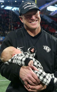 Picture of Scott Frost carrying his son Ryan  James Frost