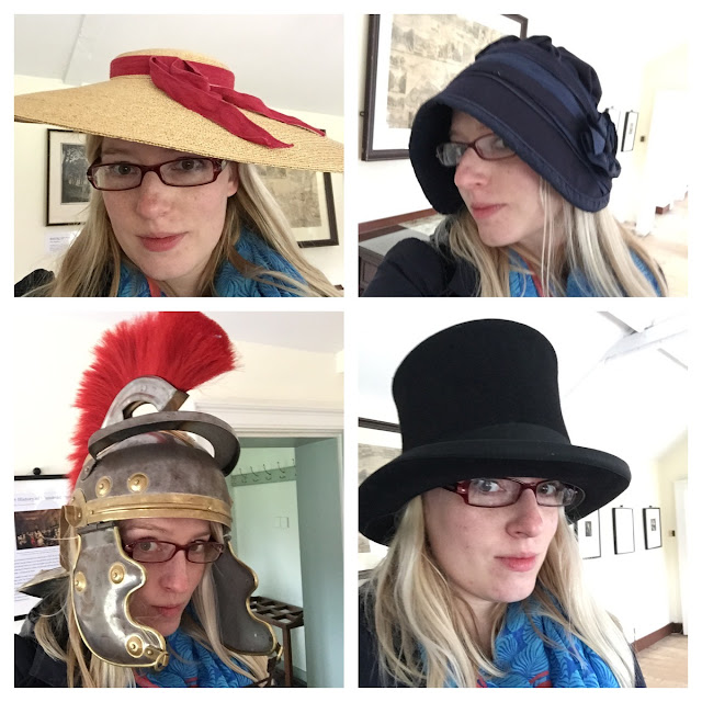 A collection of 4 photos of me wearing silly hats which don't suit my glasses