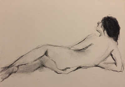 charcoal line drawing of a female nude's back while lying on her side