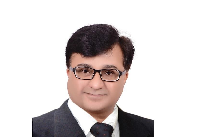 Dr. Bharat Katarmal - Cert. Endodontist, Implantologist and Prosthodontist