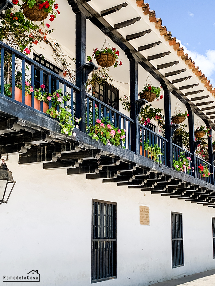 Balcony with flowering hanging planters