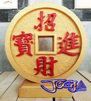 ukiran Uang emas cina bentuk bulat kepingan receh yang dibuat dari batu alam paras jogja / batu putih