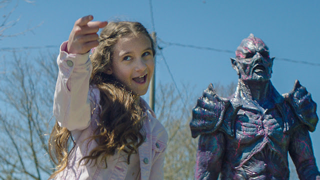 young girl and alien