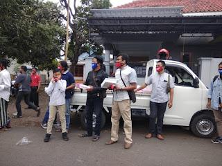 LSM Paskal Bersama Polsek Wonomerto Bagi-bagi Takjil dan Masker