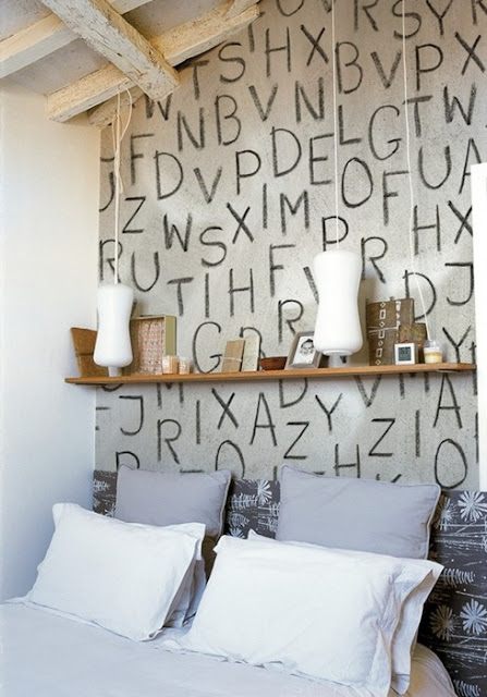 small eclectic bedroom with hang lightings