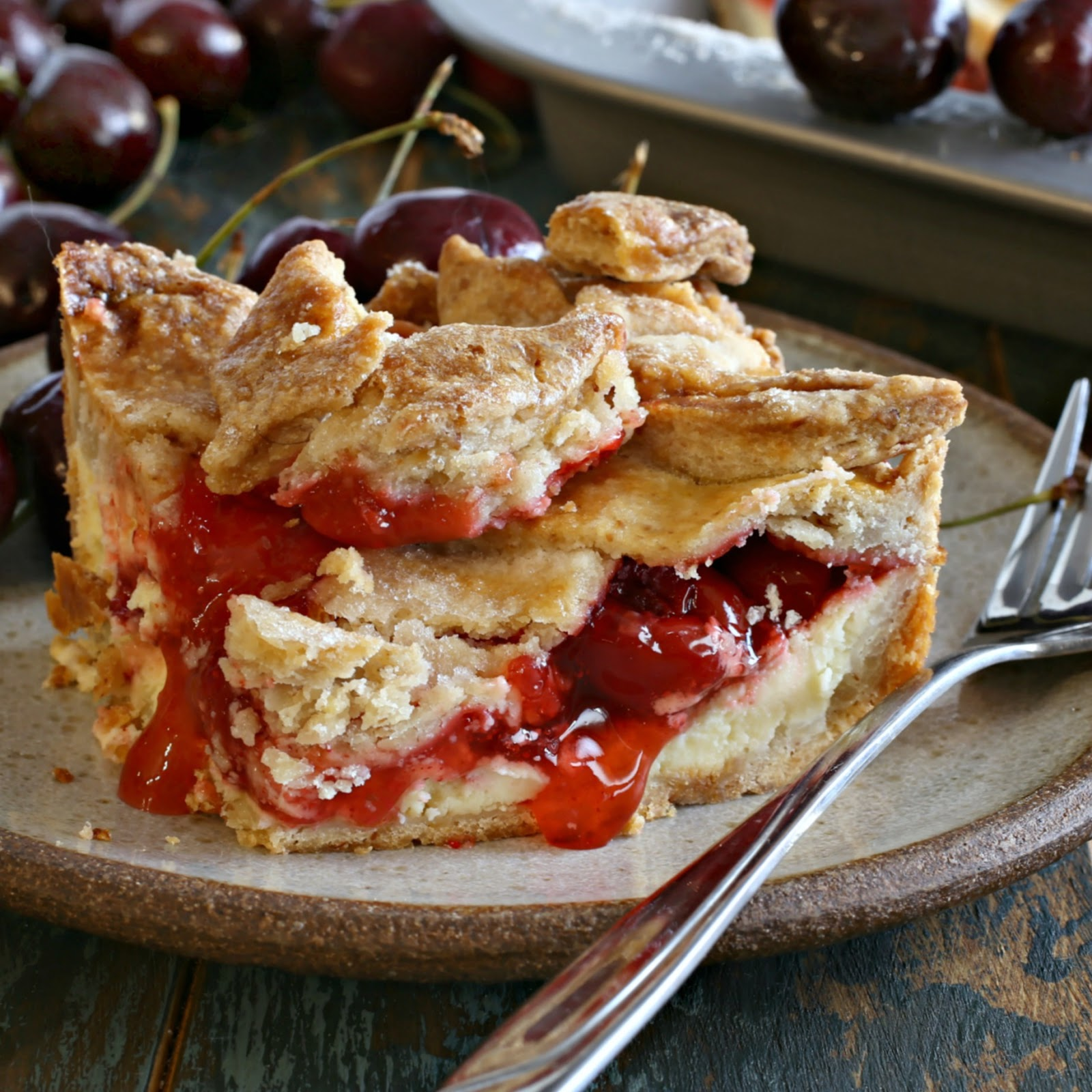 Recipe for pie with an almond cookie crust and cherry cheesecake filling.