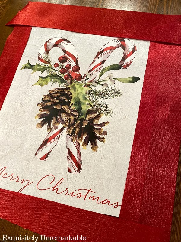 Merry Christmas Candy Cane Gift bag framed with red ribbon